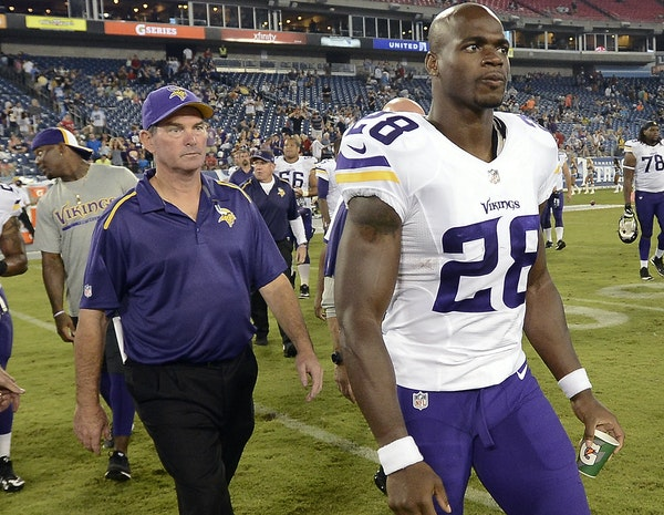 Mike Zimmer and Adrian Peterson didn't have many opportunities to walk off the field together after a game in 2014 — here, after beating the Titan