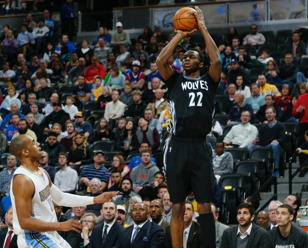 Wolves rookie Andrew Wiggins went up to shoot over Nuggets veteran Arron Afflalo in the first quarter Saturday night.