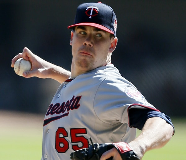 Minnesota Twins starting pitcher Trevor May delivers against the Chicago White Sox during the first inning of a baseball game Sunday, Sept. 14, 2014,