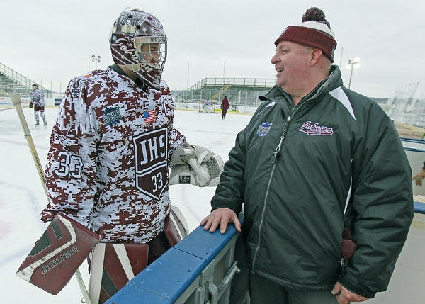 Goalie Sam Moberg and coach Moose Younghans are helping St. Paul Johnson's program survive.