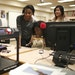 From left, Nkemdirim Orjinta, Ice King and Vivian Vuong watched the 3D printer make a sphere to represent Pluto for a solar-system project.