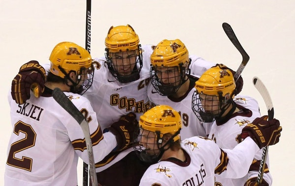 Teammates celebrated with Gopher Christian Isackson after scoring his first goal of the season during the second period.