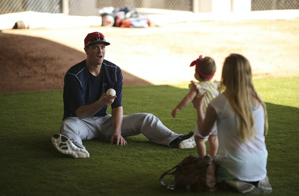 Twins righthander Kyle Gibson played with his daughter, Hayden, and his wife, Elizabeth, earlier in spring training. Hayden is preparing for her first