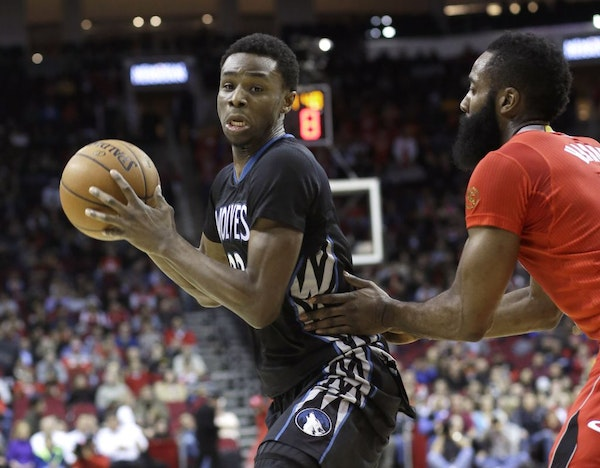 The Timberwolves' Andrew Wiggins tried to make a move on the Rockets' James Harden in the first half Monday night.