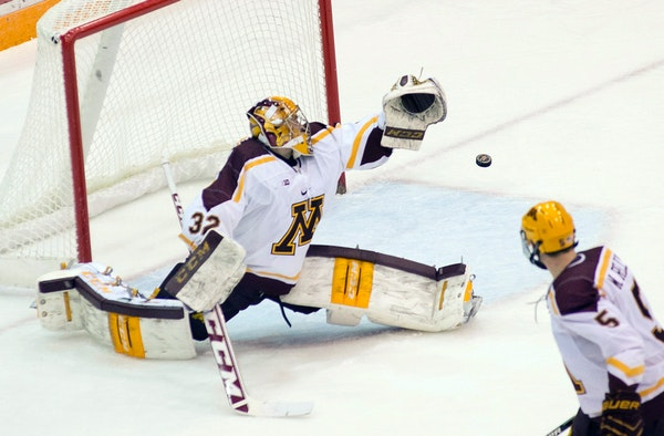 University of Minnesota goalie Adam Wilcox (32) blocks a shot by Wisconsin in the first period.