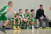 Players on one of Edina's fourth-grade boys' basketball traveling teams watched a tournament game against Chanhassen, catching their breath beside ass