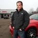 """Dan Koppy of Koppy Motors in Forest Lake is a third-generation auto dealer who is against the attempt by a lawmaker to abolish the state's """"blue l"""
