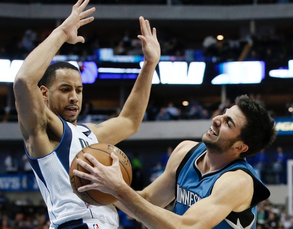 Wolves guard Ricky Rubio, right, collided with Mavericks guard Devin Harris during Monday's game in Dallas. Rubio scored 10 points in 21 minutes in hi