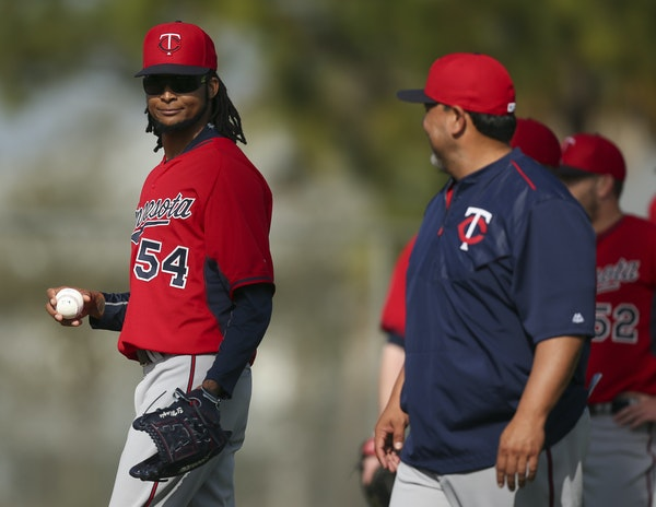 Ervin Santana smiled at Twins coach Eddie Guardado before he and other pitchers worked on a drill Tuesday morning.