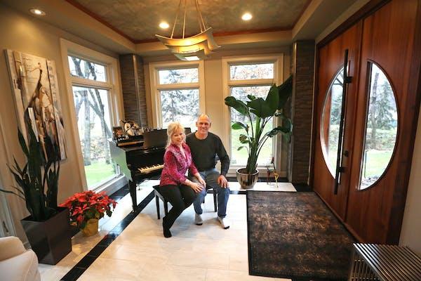 Lorri Kreuscher and her husband, Brian Koenig, in their remodeled entry.