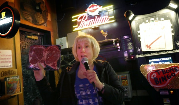 Johnna Lush held up a prize during a game of T-Bone Bingo at Grumpy's Bar in northeast Minneapolis.