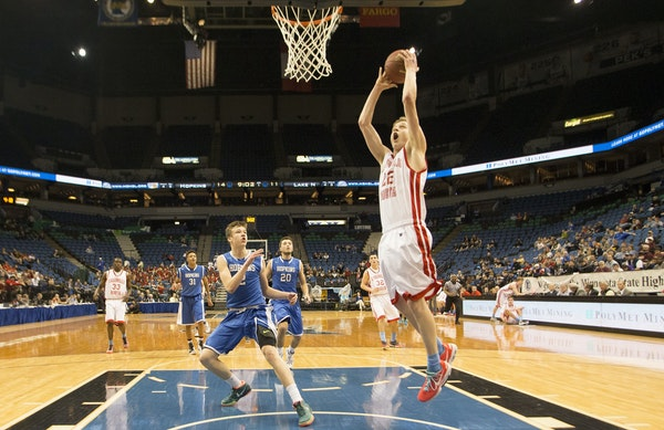Lakeville North's Carter Brooks (22) went in for a layup off a fast break against Hopkins during the first half Wednesday.