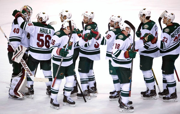 A happy bunch of Wild players celebrated after defeating the Canucks 4-2 in Vancouver on Sunday and completing a 3-0 road trip through western Canada.