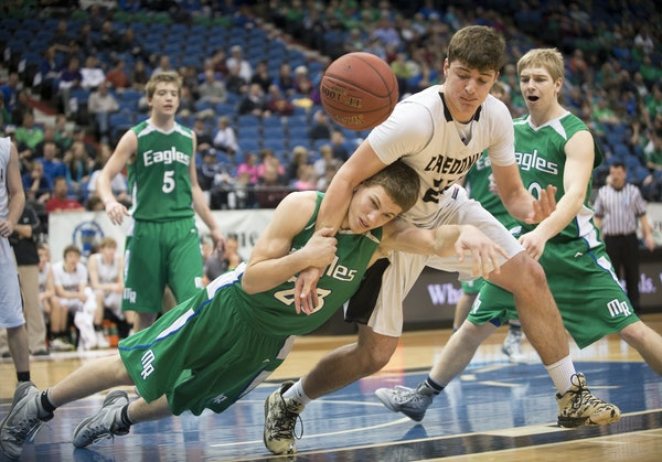 Maple River center Grant Sonnek (23) fouled Caledonia forward Justin Burg (24) as they battled for a rebound in the second half Friday at Target Cente