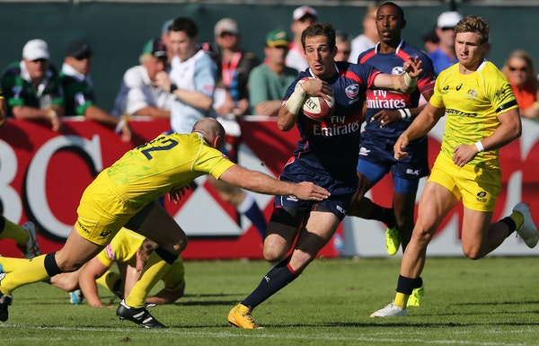 U.S. player Zack Test ran with the ball during a rugby match of HSBC Sevens World Series in Dubai, United Arab Emirates in December. A University of M