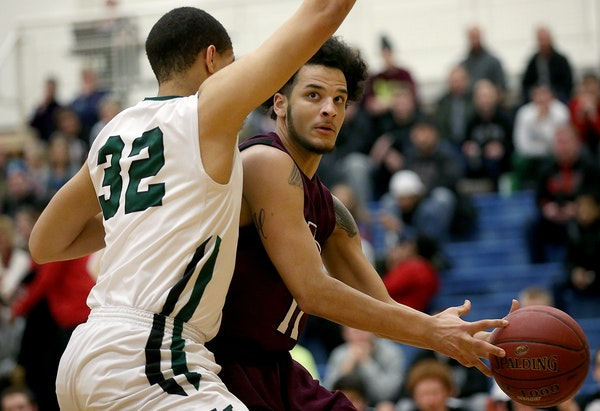 St. Paul Johnson's Justus Murphy eyed the net as Hill-Murray's Chris Moore defended (ELIZABETH FLORES/STAR TRIBUNE)