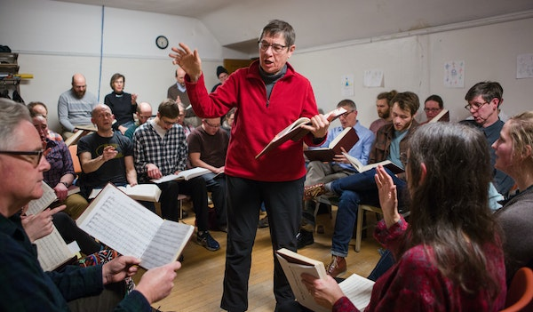 Claudia Egelhoff of Minneapolis led a group in song at University Baptist Church in Dinkytown. She has been singing shape note for 35 years after disc