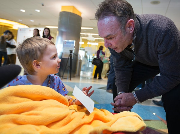 Paul Molitor gave an autographed picture to 3-year-old Decklan Hornstien of Rush City at the Masonic Children's Hospital.