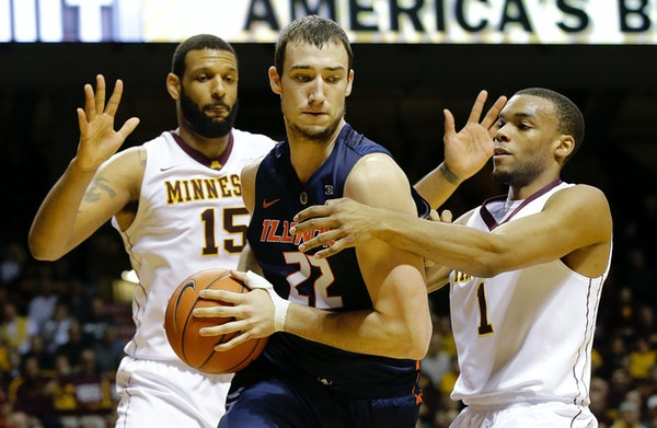 Gophers center Mo Walker (15) and guard Andre Hollins (1) were name all-Big Ten honorable mention Monday.