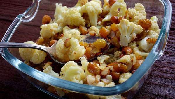 Yes, you do like cauliflower _ try it this way. Roasted Cauliflower With Almonds and Golden Raisins. Illustrates FOOD-NOURISH (category d), by Ellie K