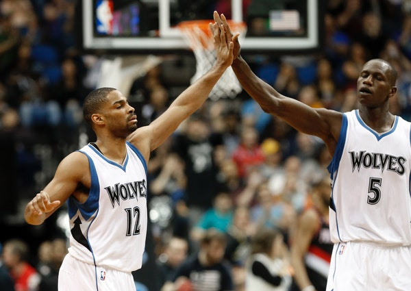 Gary Neal, left, is congratulated by Gorgui Dieng of Senegal after one of his baskets in the second half of an NBA basketball game against the Portlan