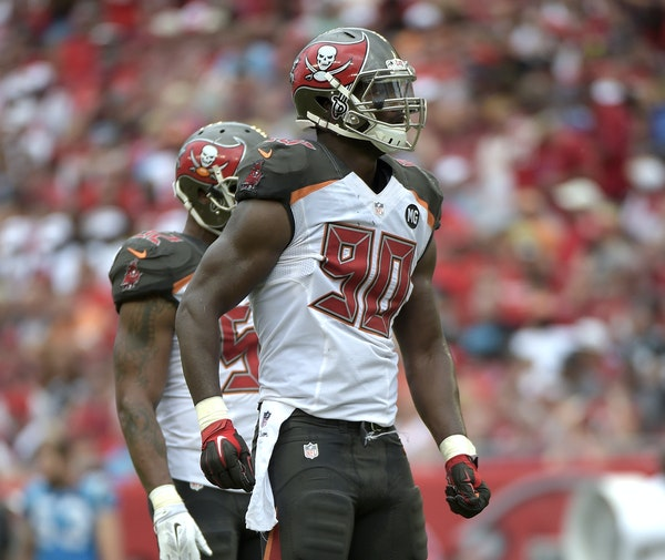 Tampa Bay Buccaneers defensive end Michael Johnson (90) waits for a play at the line of scrimmage during the second half of an NFL football game again