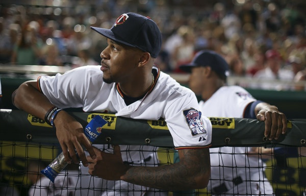 Minnesota Twins center fielder Byron Buxton waited with teammates for Thursday night's game against the Red Sox to get underway at Hammond Stadium. ]