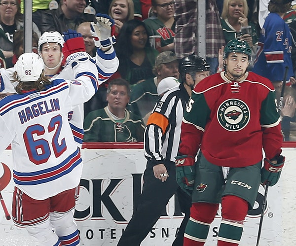 Matt Dumba (55) skated away as Rangers Dominic Moore (28) celebrated with Carl Hagelin (62) after scoring a goal in the first period.