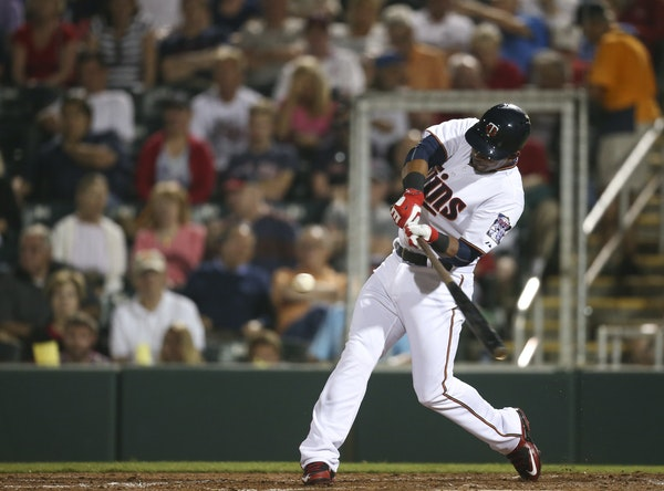 Twins infielder Eduardo Escobar belted a two-run homer in the third inning of Thursday night's Grapefruit League opener against the Red Sox at Hammo