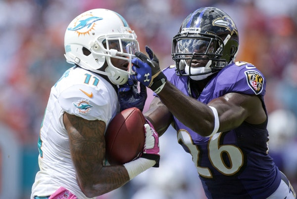 Mike Wallace of the Miami Dolphins (left)
