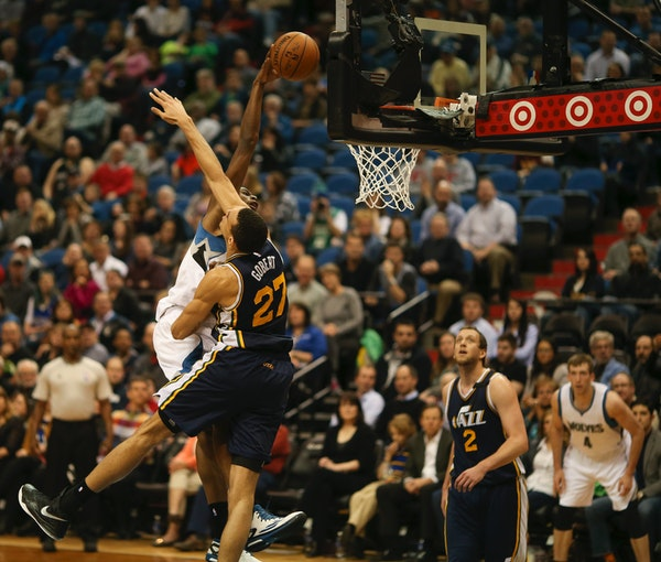 Wolves forward Andrew Wiggins dunked in the second quarter over Jazz center Rudy Gobert at Target Center on Monday night.