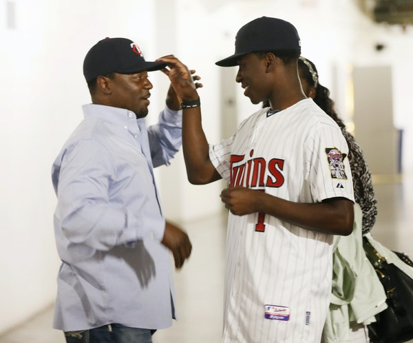 Nick Gordon, right, tipped the hat of his father, Tom Gordon, before he was introduced to the Twin Cities media last June.