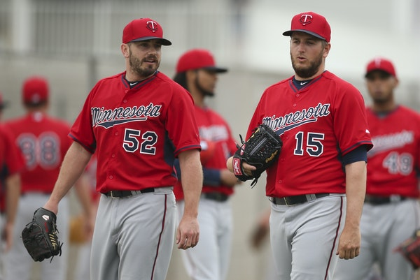 Twins bullpen pitchers Brian Duensing (52) and Glen Perkins (15) are expected to be on the final roster, but they may have slightly different roles th