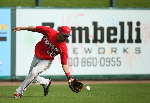 Twins outfielder Eddie Rosario fielded a grounder in the outfield during practice at Hammond Stadium.