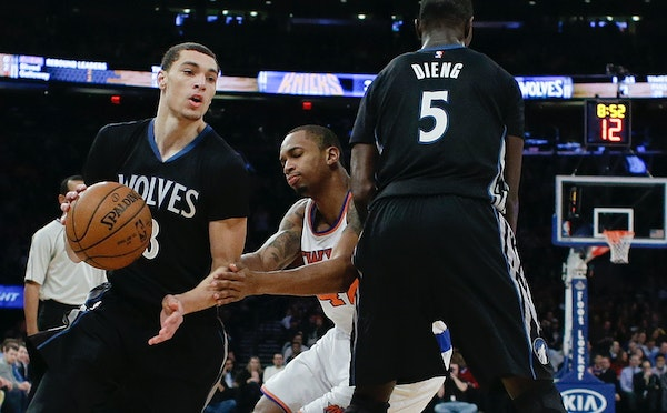 Minnesota Timberwolves' Zach LaVine (8) uses a pick set by teammate Gorgui Dieng (5) as New York Knicks' Lance Thomas (42) chases him during the first