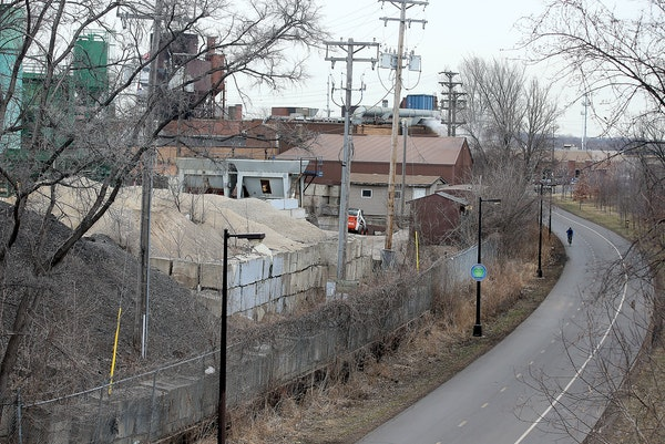 A lone bicyclist followed the path earlier this week along the Midtown Greenway near E. 28th Street and Cedar Avenue, an area with nonconforming zonin