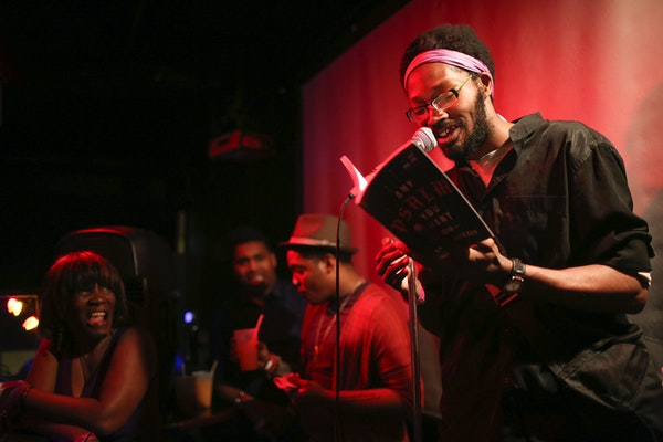 Khary Jackson read from his work during The Prince Purple Poetry Party Wednesday night at First Ave.