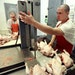 Shawn Wirta, right, and Zach Malich, inmates at the Northeast Regional Corrections Center near Duluth, butchered chickens.