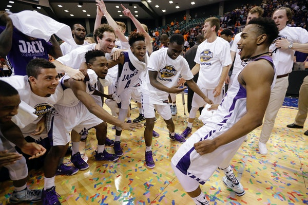 Stephen F. Austin's Trey Pinkney, right, dances as he celebrates with teammates after an NCAA college basketball game against Sam Houston State in the