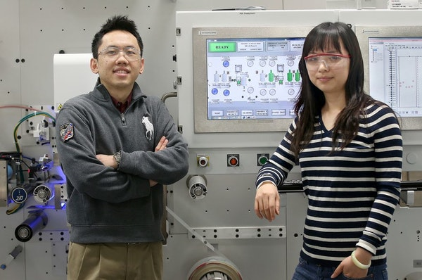 Au ChunXing, left, from Malaysia and Yahui Zhang from China, work as engineers at LasX Industries. Experts are predicting another short application se