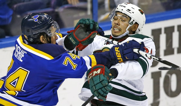 St. Louis' T.J. Oshie introduced Wild youngster Matt Dumba to the Blues' heavy-handed physical style during a March 14 showdown in St. Louis.