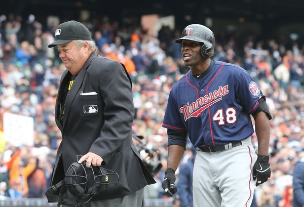 Minnesota Twins' Torii Hunter argues his strike three call with home plate umpire Joe West that ended the game in the ninth inning of an opening day b