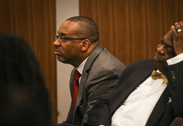 Outgoing Urban League President and CEO Scott Gray, left, and Chair Clinton Collins Jr. attended a Minneapolis school board meeting where board member