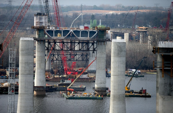 Construction crew worked high above the St. Croix on the bridge that will connect Wisconsin and Minnesota, Friday, April 10, 2015 near Stillwater, MN.
