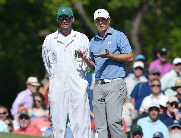 Jordan Spieth and his caddie, Michael Greller, worked out details on the No. 7 green. Putting has been a strength for Spieth.