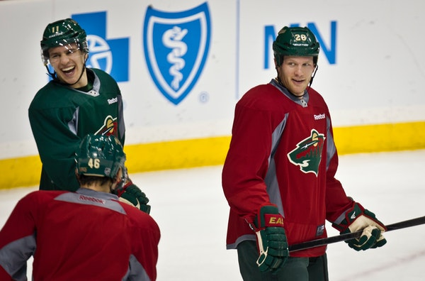 Zach Parise (11) and Ryan Suter (20) in 2013.