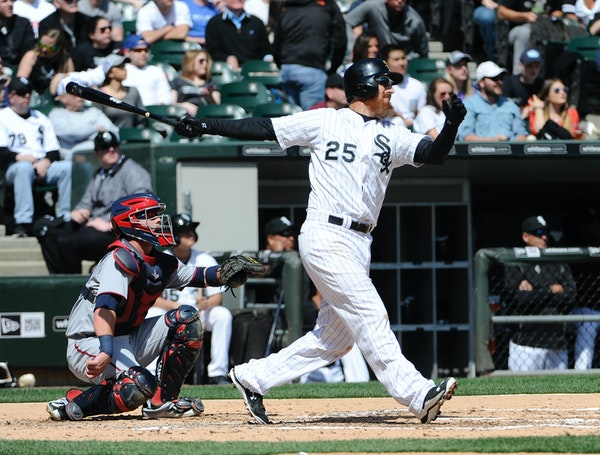 Chicago White Sox's Adam LaRoche (25) watches his home run against the Minnesota Twins during the second inning of a baseball game, Saturday, April 11