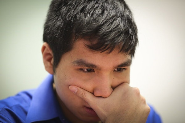 Chess Grandmaster Wesley So concentrated as he played chess with Sean Nagle at the Ridgedale Public Library on Friday, February 27, 2015 in Minnetonka