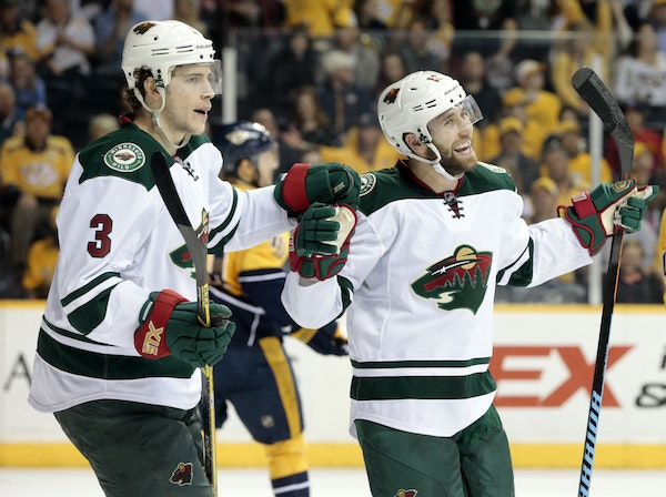 Minnesota Wild left wing Jason Zucker, right, celebrates with Charlie Coyle (3) after Zucker scored a goal against the Nashville Predators in the seco