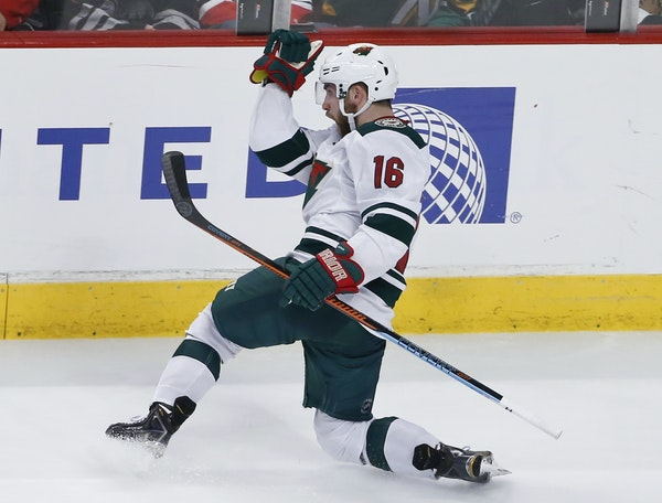 Minnesota Wild left wing Jason Zucker (16) celebrates a goal against the Chicago Blackhawks during the third period of an NHL hockey game Tuesday, Apr